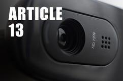 Een moderne Webcamera op monitor en artikel 13 inschrijving royalty-vrije stock foto's