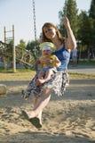 Een moeder en haar kind Stock Foto