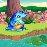 Een moedermonster en haar kind bij riverbank Stock Foto's