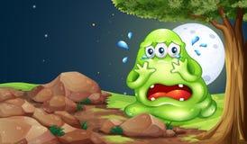 Een monster die dichtbij de rotsen schreeuwen stock illustratie