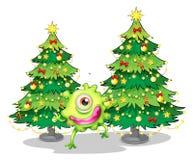Een monster die voor de Kerstmisbomen dansen Stock Fotografie