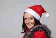 Een mooi meisje kleedde zich als Kerstman Royalty-vrije Stock Foto's
