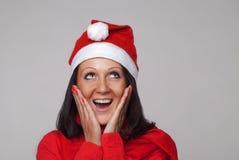 Een mooi meisje kleedde zich als Kerstman Stock Foto