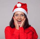 Een mooi meisje kleedde zich als Kerstman Royalty-vrije Stock Foto