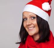 Een mooi meisje kleedde zich als Kerstman Stock Afbeelding