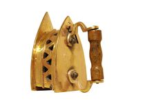 Een mooi oud Gouden die ijzer op wit wordt geïsoleerd stock foto
