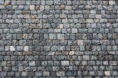 Een mooie horizontale textuur van een deel van een oude grijze bakstenen muur van bevroren vulkanische lava van de vulkaan van Et stock foto's