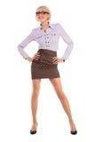 Een mooie jonge vrouw in bedrijfskledij op een wh Stock Foto