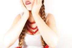 Een mooie schuwe jonge volksvrouw Stock Fotografie