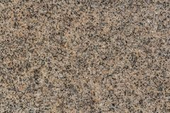 Een mooie textuur van de natuurlijke grijze en gele oppervlakte van de granietsteen in de foto stock afbeeldingen