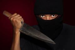 Een moordenaarspersoon met scherp Royalty-vrije Stock Foto's