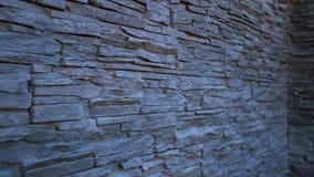 Een muur die met decoratieve steen wordt gevoerd Stock Foto