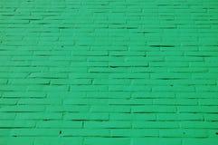 Een muur met groene bakstenen Royalty-vrije Stock Foto