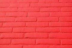 Een muur met rode bakstenen Stock Afbeelding