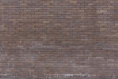 Een muur van donkere bakstenen Royalty-vrije Stock Foto's