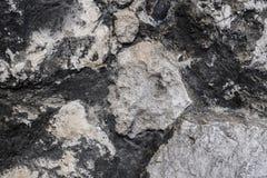 Een muur van stenen wordt gemaakt die Natuurlijke Textuur Achtergrond stock afbeelding
