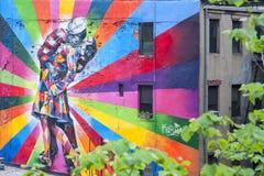 Een Muurschildering op de muur in New York, NY Stock Fotografie