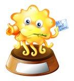 Een nadenkend monster boven de trofee Stock Foto