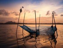 Een net van de visser op het water Stock Afbeelding