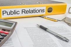 Een omslag met de etiketpublic relations Stock Afbeelding