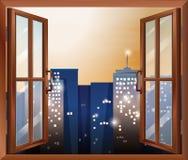 Een open venster over de hele stad gebouwen Stock Foto's