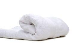 Een opgerolde witte handdoek Stock Foto's