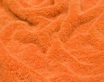 Een oranje geslagen handdoek, rekening Stock Afbeeldingen
