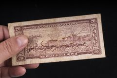 Een oud bankbiljet van Angola Stock Foto's