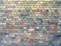 Een oude bakstenen muurachtergrond stock foto's