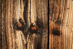 Een oude houten oppervlakte met knopen Achtergrond Textuur Royalty-vrije Stock Foto's