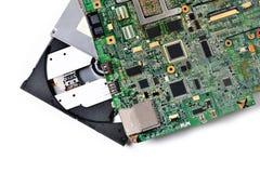 Een oude micro- kring voor laptop en een CD-rom, Witte achtergrond Royalty-vrije Stock Afbeelding