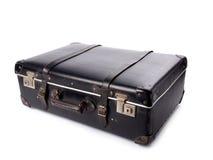 Een oude zwarte uitstekende leerkoffer met riemen en sloten Stock Afbeelding