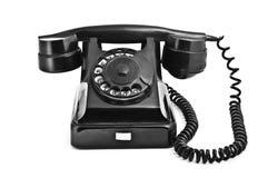 Een oude zwarte uitstekende roterende stijltelefoon Stock Foto