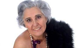 Een oudere vrouw met sexy gesteld op witte achtergrond royalty-vrije stock afbeeldingen