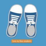 Een paar blauwe tennisschoenen op blauwe achtergrond Stock Illustratie