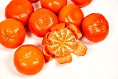 een paar die Mandarin op witte achtergrond wordt geïsoleerd stock afbeelding