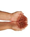 Een paar handen die samen op een witte achtergrond tot een kom worden gevormd Stock Foto