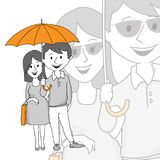 Een paar op middelbare leeftijd onder een paraplu Stock Afbeelding