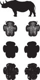 De zwarte sporen of de voetafdrukken van de Rinoceros Stock Foto's