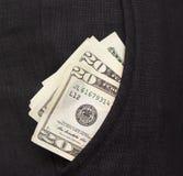 Een paar rekeningen in zijn broekzak Stock Fotografie