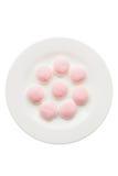 Een paar stukken van roze en witte suikergoed en gelei in de vorm van Royalty-vrije Stock Afbeeldingen