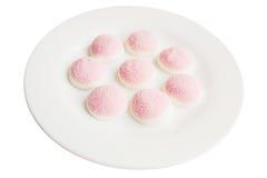 Een paar stukken van roze en witte suikergoed en gelei in de vorm van Royalty-vrije Stock Fotografie
