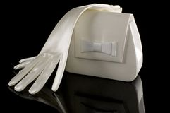Een paar van handschoenen en een beurs Royalty-vrije Stock Afbeeldingen