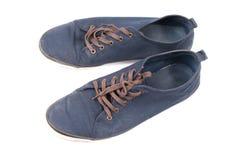 Een paar van het lopen van blauwe tennisschoenen Stock Foto
