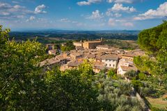 Een panorama een Toscanië het dorpserfenis van van San Gimignano, van Unesco stock afbeelding