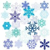 Een patroon van sneeuwvlokken in verschillende vormen in blauwe kleuren Stock Fotografie