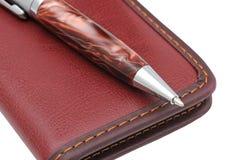 Een pen en een notitieboekje Stock Foto