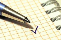 Een pen en een tikteken Stock Foto