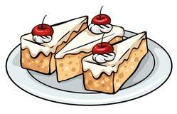 Een plaat met cakes Stock Afbeelding