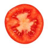 Een plak van tomaat, op wit wordt geïsoleerd dat Royalty-vrije Stock Afbeeldingen